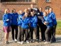 Danmarksmestrene i volleyball fejrer deres medspiller og træner